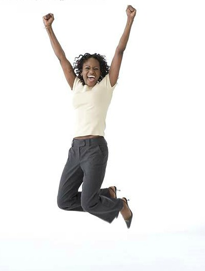 African American woman jumping and cheering