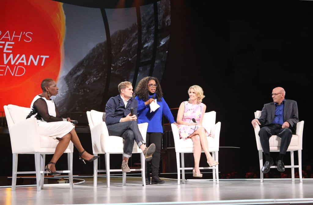 "Oprah Winfrey on stage with tour ""trailblazers"" (from left) Iyanla Vanzant, Pastor Rob Bell, Elizabeth Gilbert and Mark Nepo at the Verizon Center in Washington, D.C. on Saturday, September 20, 2014.  This was the third stop of Winfrey's eight-city arena tour, ""Oprah's The Life You Want Weekend,"" traveling throughout the U.S. this fall. Courtesy of Harpo Studios, Inc. / George Burns"