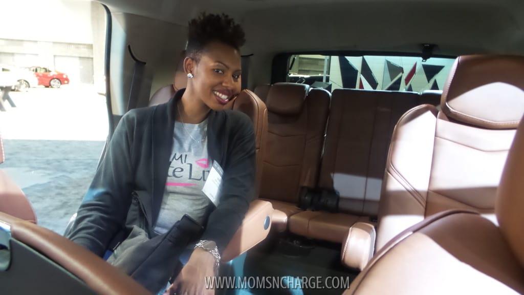 "Michellette ""Mimi"" Green (Mimi Cute Lips) posing in the back of the Escalade"