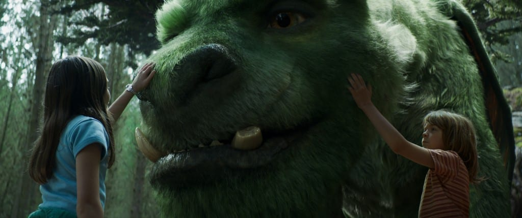 Oakes Fegley is Pete and Oona Laurence is Natalie in Disney's PETE'S DRAGON, the story of a boy named Pete and his best friend Elliot, who just happens to be a dragon. Photo credit: Disney