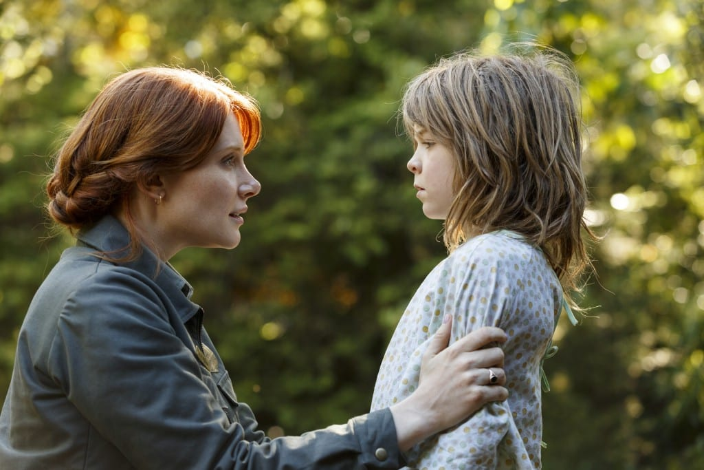Bryce Dallas Howard is Grace and Oakes Fegley is Pete in Disney's PETE'S DRAGON, the adventure of an orphaned boy and his best friend Elliott, who just so happens to be a dragon.