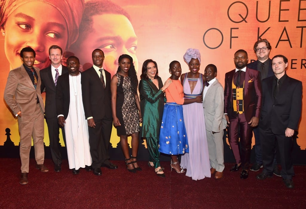 "HOLLYWOOD, CA - SEPTEMBER 20: (L-R) Executive Vice President of Production, The Walt Disney Studios, Tendo Nagenda, President of Walt Disney Studios Motion Picture Production, Sean Bailey, chaperone Mark Mugwana, Chess Coach and Director of Sports Outreach in Uganda, Robert Katende, Ugandan national chess champion Phiona Mutesi, Director Mira Nair, actors Madina Nalwanga, Lupita Nyong'o, Martin Kabanza and David Oyelowo, screenwriter William Wheeler and composer Alex Heffes arrive at the U.S. premiere of Disney's ""Queen of Katwe"" at the El Capitan Theatre in Hollywood. The film, starring David Oyelowo, Oscar winner Lupita Nyong'o and newcomer Madina Nalwanga, is directed by Mira Nair and opens in U.S. theaters in limited release on September 23, expanding wide September 30, 2016. On September 20, 2016 in Hollywood, California. (Photo by Alberto E. Rodriguez/Getty Images for Disney) *** Local Caption *** Tendo Nagenda; Mark Mugwana; Madina Nalwanga; Lupita Nyong'o; David Oyelowo; Sean Bailey; Robert Katende; Phiona Mutesi; Mira Nair; Martin Kabanza; William Wheeler; Alex Heffes"