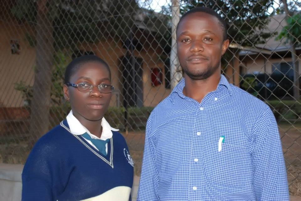 The real Phiona Mutesi and Robert Katende who inspired the film. (Photo credit: Disney)
