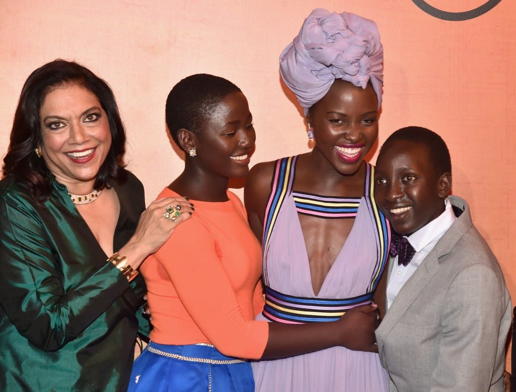 """HOLLYWOOD, CA - SEPTEMBER 20: (L-R) Director Mira Nair, actors Madina Nalwanga, Lupita Nyong'o and Martin Kabanza arrive at the U.S. premiere of Disney's """"Queen of Katwe"""" at the El Capitan Theatre in Hollywood. The film, starring David Oyelowo, Oscar winner Lupita Nyong'o and newcomer Madina Nalwanga, is directed by Mira Nair and opens in U.S. theaters in limited release on September 23, expanding wide September 30, 2016. On September 20, 2016 in Hollywood, California. (Photo by Alberto E. Rodriguez/Getty Images for Disney) *** Local Caption *** Mira Nair; Madina Nalwanga; Lupita Nyong'o; Martin Kabanza"""
