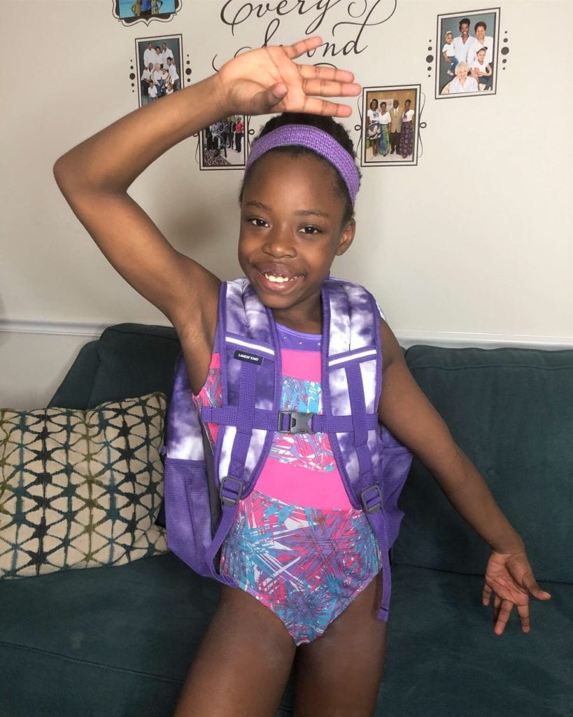 gymnast Brielle shows off her new backpack