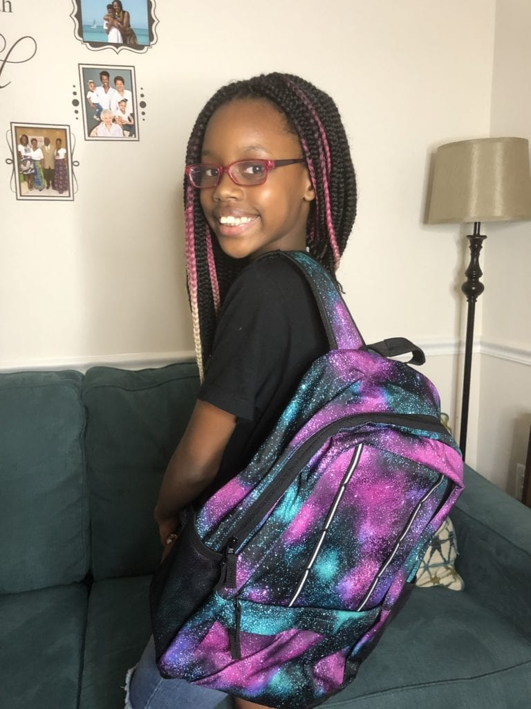 Livy showing off her new backpack from LandsEnd