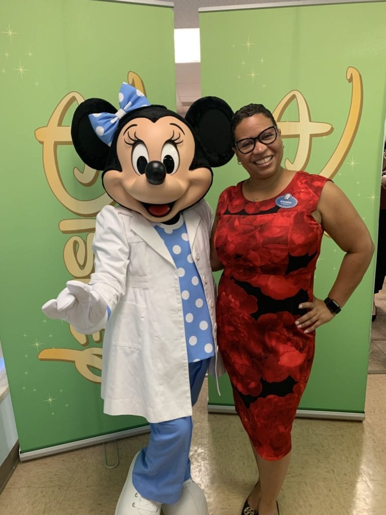 D'Anna Craighead techology manager with Minnie Mouse at Disney
